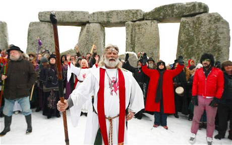 Druids, lead by Arthur Pendragon (centre), take part in the winter solstice at Stonehenge in Wiltshire